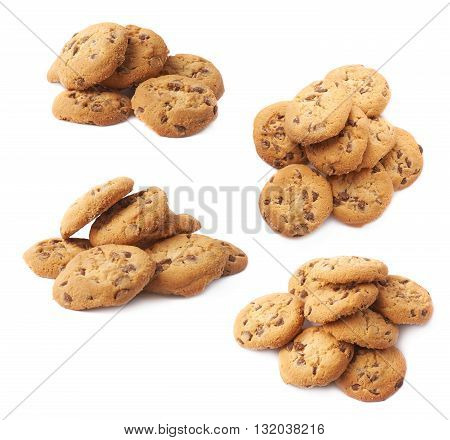 Pile of round cookies with the pieces of chocolate isolated over the white background, set of four different foreshortenings