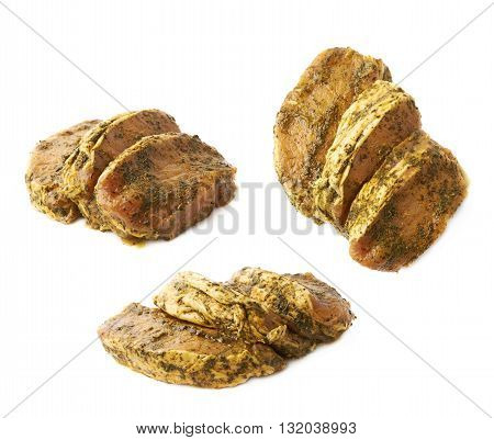 Three marinated with herbs beef slices isolated over the white background, set of three different foreshortenings