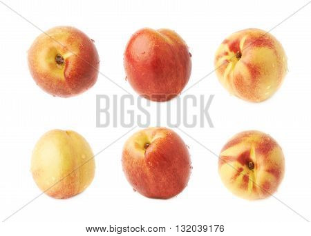 Single ripe nectarine covered with water drops, isolated over the white background, set of six different foreshortenings