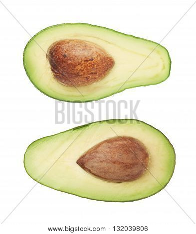 Cut in half open ripe avocado fruit with the pit, isolated over the white background, set of two different foreshortenings
