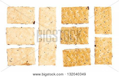 Five single raisin cracker cookies isolated over the white background, each in two different foreshortenings