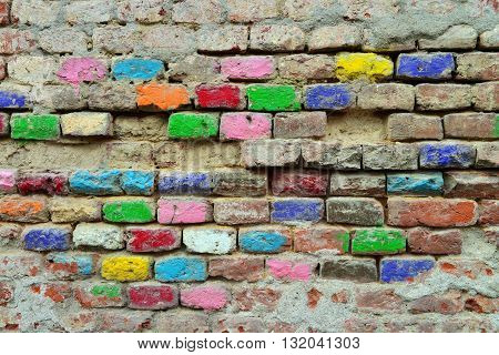 old grunge wall with manny colored bricks