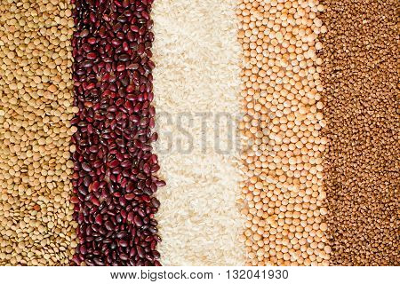 Grain and beans striped background. Various types of seeds. beans, peas, buckwheat, lentils, rice. healthy food and diet concept. Grain and beans background. top view