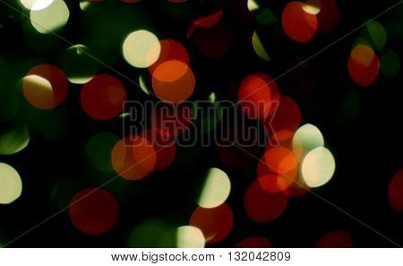 abstract red and green christmas lights on black