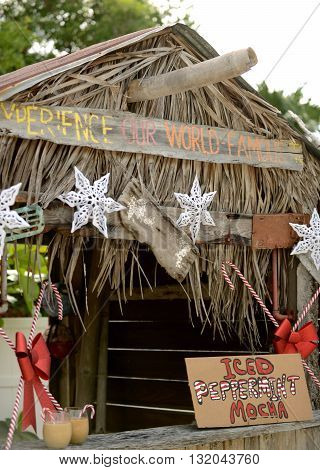 Tropical christmas or winter holiday concept with an iced peppermint mocha stand