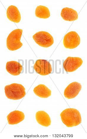 Dried orange apricots over isolated white background, top view
