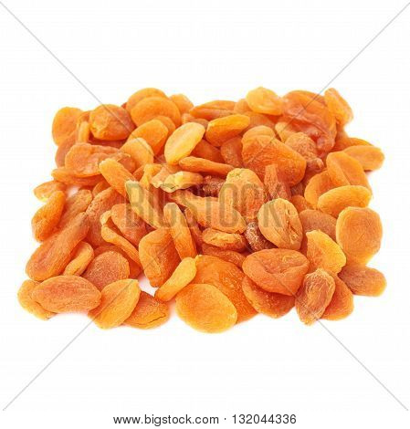 Pile of dried orange apricots over isolated white background