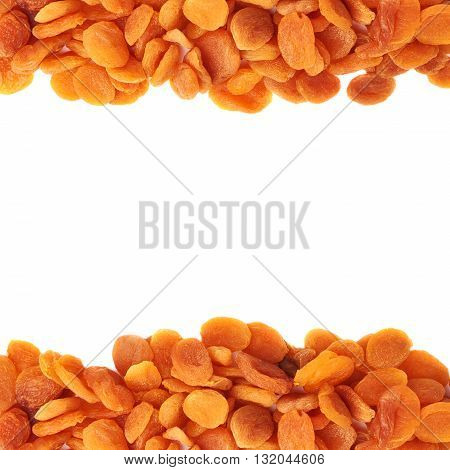 Line made of dried orange apricots over isolated white background, top view