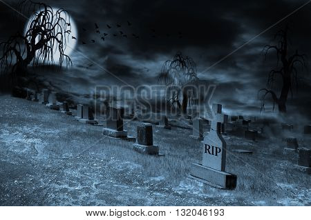 Graveyard on a supermoon-lit night with tombstones dark clouds fog and spooky trees. Silhouette of ravens flying and copy space.