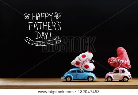 Fathers Day message with pink and blue cars carrying heart cushions