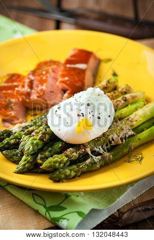 Delicious roasted green asparagus poached egg and smoked salmon on plate