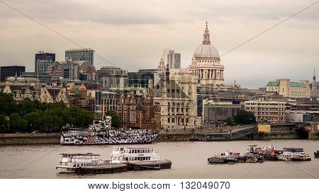 London United Kingdom - July 27 2014. London buildings near the river Thames. London is the capital city of the United Kingdom and a very popular tourist destination.