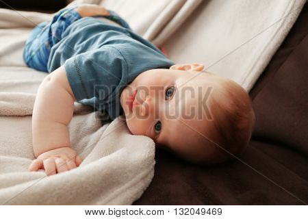 Adorable baby on the couch