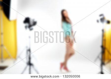 Female silhouette in studio, blurred background