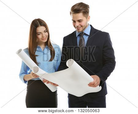 Engineers with blueprints isolated on white