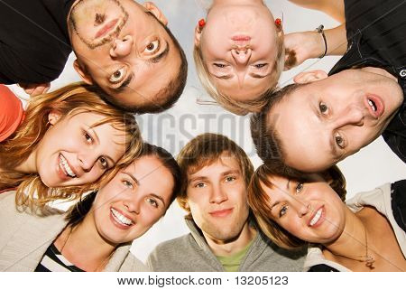 Group of happy friends making funny faces