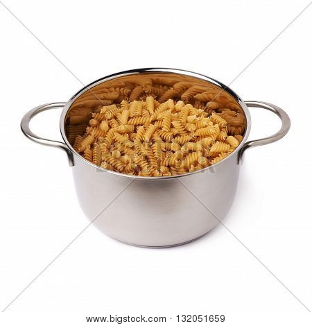 Metal pan filled with dry rotini yellow pasta over isolated white background