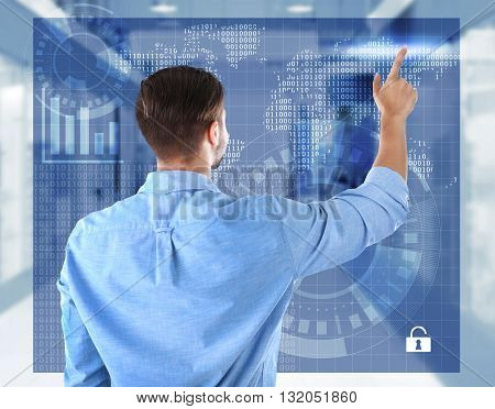 Businessman working with virtual screen. Futuristic technology