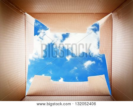 Looking on blue sky. Thinking outside the box concept