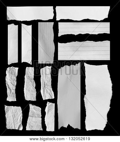 White torn of paper isolated on a black background. Copy space