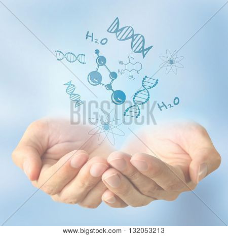 Scientist  hands with chemical formulas. Concept of future technology