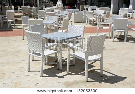 modern table and chairs in street caffe