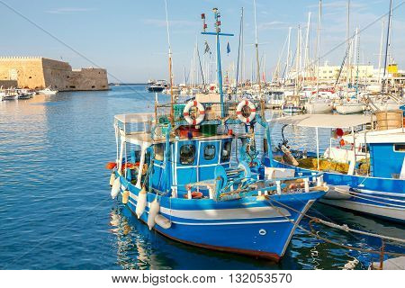 Fishing multi-colored boats in the old harbor of Heraklion. Crete. Greece.