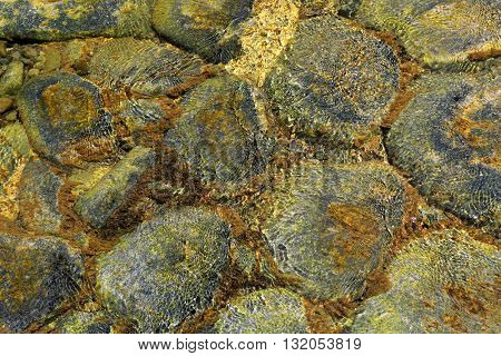 old stones in water - abstract natural background