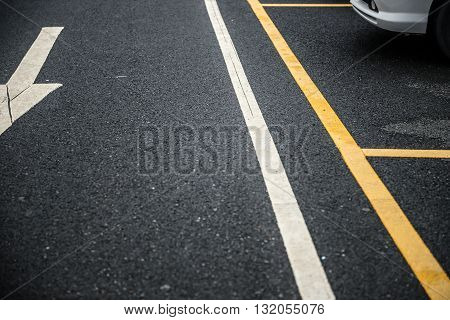 outdoor car parking lot with arrow sign