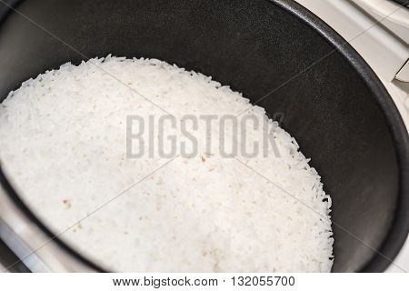 steamed rice in the inner pot of electric rice cooker