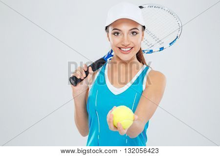 Portrait of a happy female tennis player looking at camera isolated on a white background