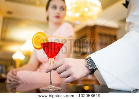 Beautiful attractive woman in evening dress making an order