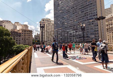 SAO PAULO, BRAZIL - CIRCA JAN 2015: People walking at Efigenia bridge in Sao Paulo, Brazil.