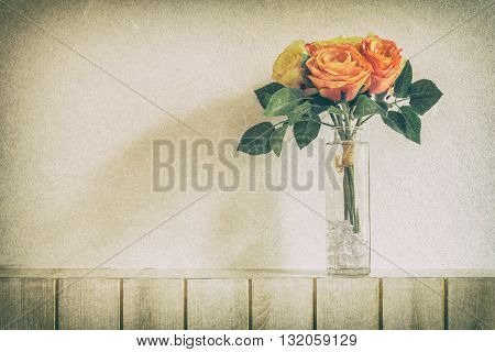 Pastel Artificial Pink Rose Wedding Bridal Bouquet in flower pot on white wooden background with grunge and vintage tone.