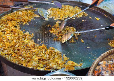 Thai cuisine. Shellfish fried in local Thai market