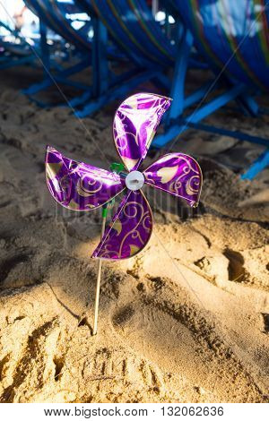 violet of pinwheel in beach, hand made toy