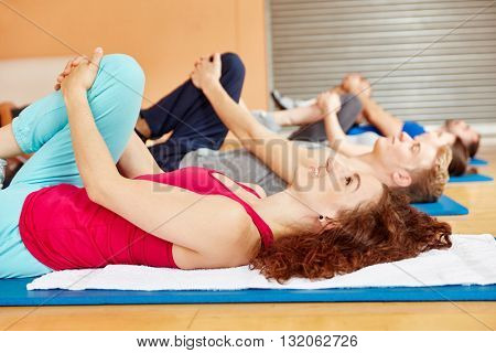 Stretching exercise during pilates class at fitness studio