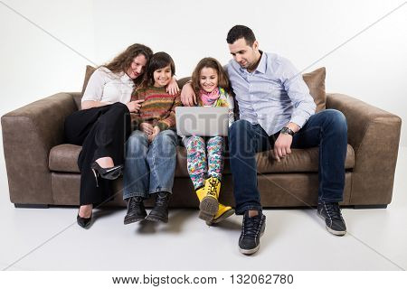 Family at home sitting at sofa