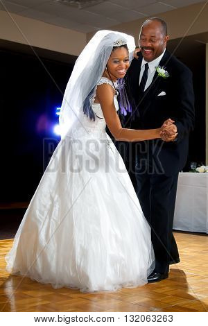 A bride dances with her dad during the father daughter dance at her wedding.