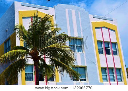 Colorful art deco style historic building surrounded with Palm Trees taken in Miami Beach, FL