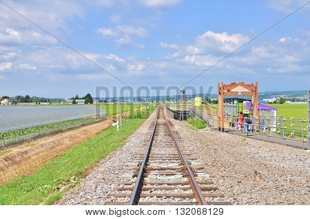 Hokkaido, Japan - July 23, 2013: Sign of lavender farm station and railroad at Furano, Hokkaido - Japan. This station is near Tomita farm.