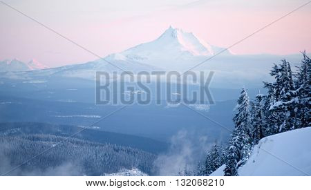 Mt Jefferson can be seen miles away from a vantage point high on Mt Hood on a crisp winter evening