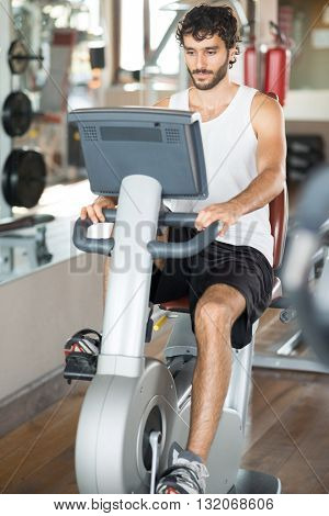 Man working out on a stationary bike in a gym