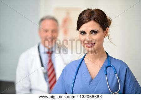Portrait of smiling doctors in their office