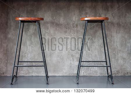 Elegant chairs with empty concrete background, stock photo