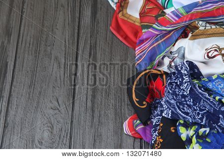 Pile of colorful scarves on a table.