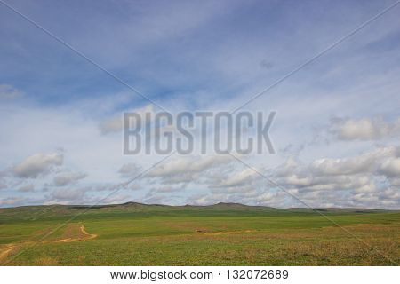 Spring in the steppe and blues sky with clouds - near Almaty Kazakhstan 2016