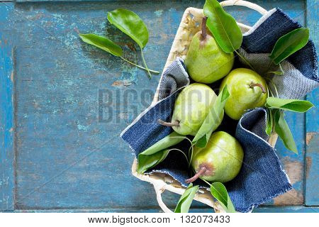 Harvest Fresh Organic Juicy Pears In A Wicker Basket On A Rustic Wooden Table, Top View With Copy Sp