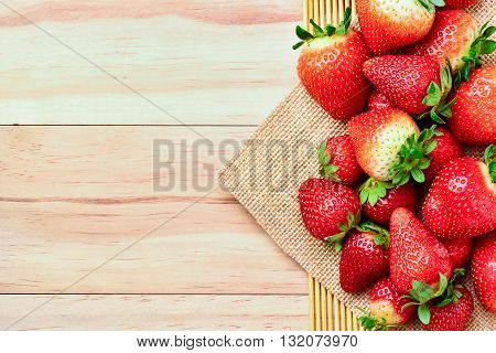 A Strawberry on wooden background top view