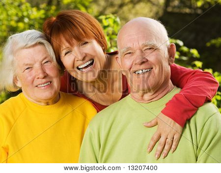 Senior couple with their daughter outdoors